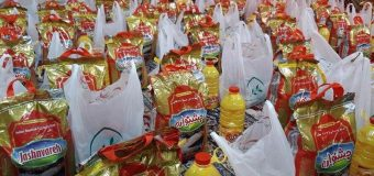 Eulogizers Community Gives out Food to Needy in Holy Qom